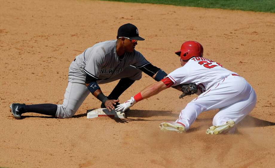 Los Angeles Angels' Mike Trout, right, is tagged out by New York Yankees second baseman Starlin Castro as he tries to steal second during the eighth inning of a baseball game, Sunday, Aug. 21, 2016, in Anaheim, Calif. The Angels won 2-0. (AP Photo/Mark J. Terrill) ORG XMIT: ANS112 Photo: Mark J. Terrill / Copyright 2016 The Associated Press. All rights reserved. This m