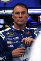 SPARTA, KY - JULY 08: Kevin Harvick, driver of the #4 Busch Light Chevrolet, stands in the garage area during practice for the NASCAR Sprint Cup Series Quaker State 400 at Kentucky Speedway on July 8, 2016 in Sparta, Kentucky.  (Photo by Jerry Markland/Getty Images)
