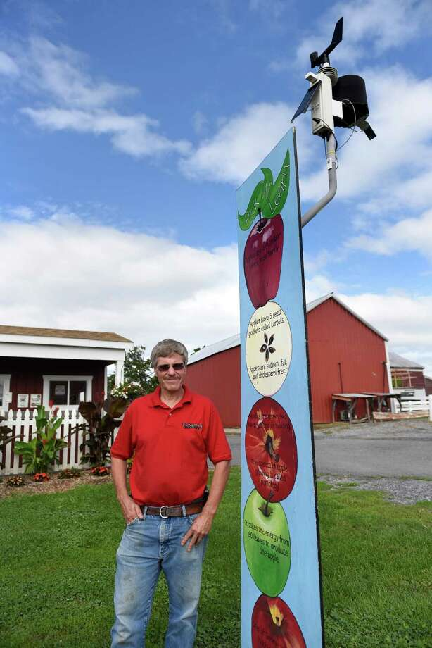 Kevin Bowman stands by his weather station that's tied into the Network for Environment and Weather Applications on Wednesday, Aug. 17, 2016, at Bowman Orchards in Clifton Park, N.Y. He uses the data daily, and sometimes hourly, to make decisions on how to treat his crops. (Cindy Schultz / Times Union) Photo: Cindy Schultz / Albany Times Union