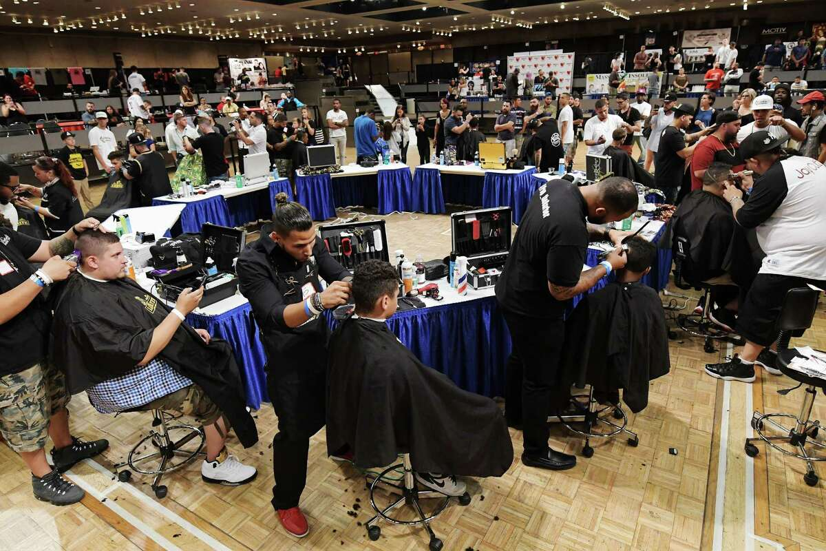 Barbers compete in the freestyle design hair cutting competition at the first annual New York State Barber Expo at the Empire State Plaza Convention Center on Sunday, Aug. 21, 2016, in Albany, N.Y. Marlon Sousis and Peter Burdick who co-own Hall of Fades Barber Shop in Rensselaer and Jason Belleville organized the expo as a way to unite the barber community in the area Sousis said. The event featured over 60 vendors from around the country and four different barber competitions. The event also featured educators who ran classes on marketing, branding, and various hair cutting techniques. (Paul Buckowski / Times Union)