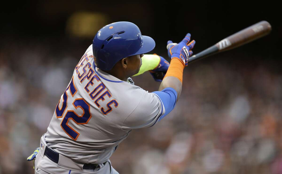 New York Mets' Yoenis Cespedes sings for a two run home run off San Francisco Giants' Jeff Samardzija in the seventh inning of a baseball game, Sunday, Aug. 21, 2016, in San Francisco. (AP Photo/Ben Margot)