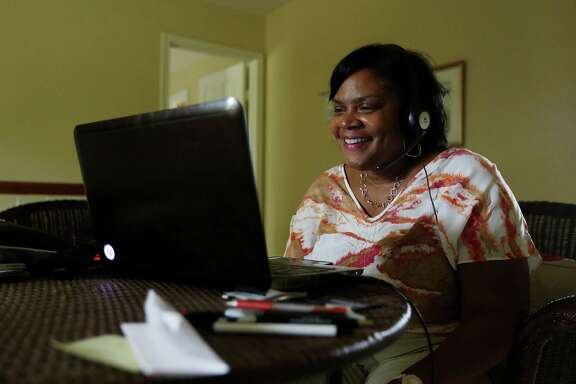 Sitting in her home, Shelia Muldrow smiles as she sees her son Warren for the first time in over two weeks on a video chat screen last week. He began to sing her a song from his childhood.