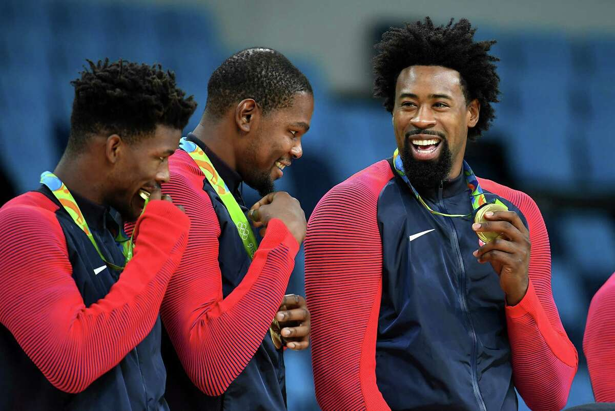 The two Houston-area players on the U.S. team - Jimmy Butler, left, and DeAndre Jordan, right - flank University of Texas product Kevin Durant after receiving their gold medals Sunday.