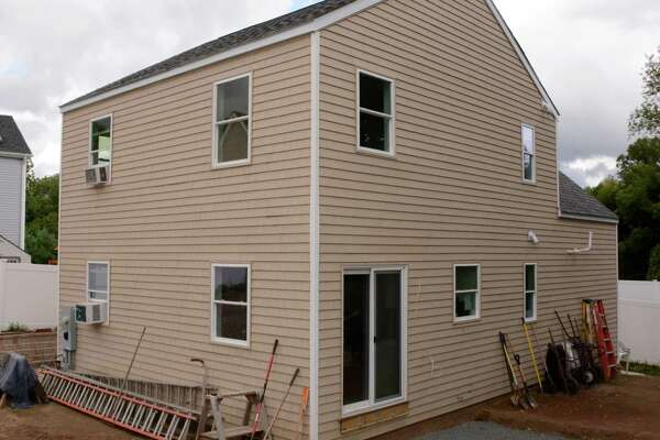 Housatonic Habitat for Humanity celebrated completion of this home for a New Milford family on Sunday.
