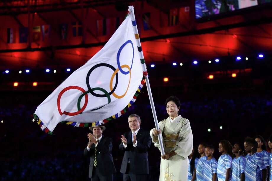 RIO DE JANEIRO, BRAZIL - AUGUST 21:  Mayor of Rio de Janeiro Eduardo Paes, IOC President Thomas Bach and Governor of Tokyo Yuriko Koike take part in the Flag Handover Ceremony during the Closing Ceremony on Day 16 of the Rio 2016 Olympic Games at Maracana Stadium on August 21, 2016 in Rio de Janeiro, Brazil.  (Photo by Cameron Spencer/Getty Images) ORG XMIT: 595937415 Photo: Cameron Spencer / 2016 Getty Images