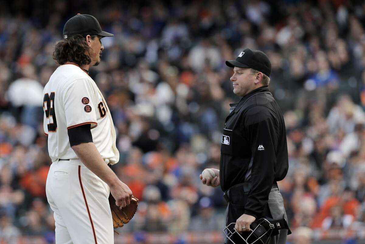 Jeff Samardzija (29) talks to homeplate umpire Clint Fagan after Samardzija walked Noah Syndergaard in the third inning as the San Francisco Giants played the New York Mets at AT&T Park in San Francsico, Calif., on Sunday, August 21, 2016. The Mets defeated the Giants 2-0.