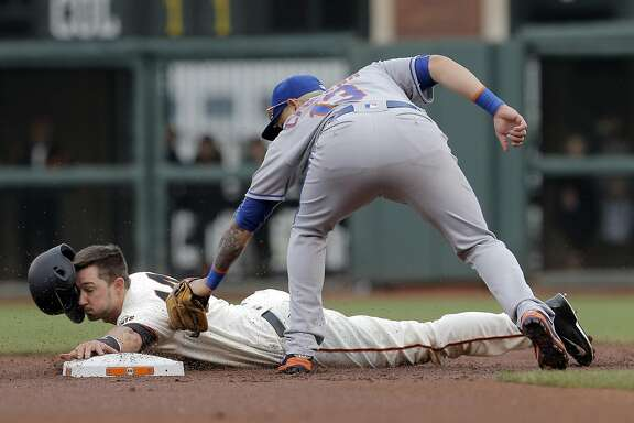 Trevor Brown (14) is tagged out at second trying to steal in the third inning as the San Francisco Giants played the New York Mets at AT&T Park in San Francsico, Calif., on Sunday, August 21, 2016. The Mets defeated the Giants 2-0.