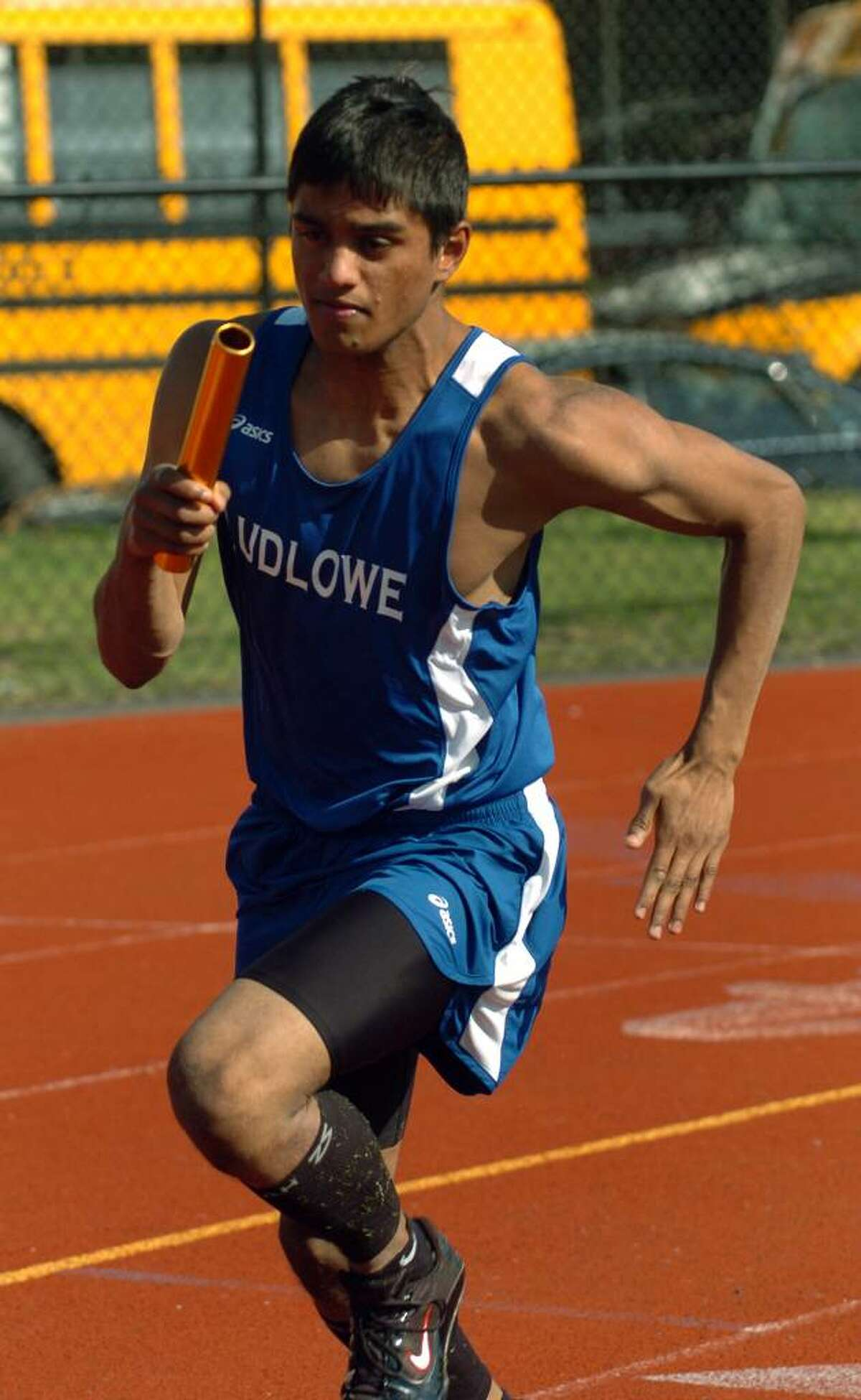 Fairfield Ludlowe's Nabid Ahmed competes in the 4X100 relay, during track action in Fairfield, Conn. on Friday April 30, 2010.