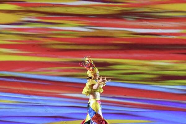 A dancer performs during the closing ceremony of the Rio 2016 Olympic Games at the Maracana stadium in Rio de Janeiro on August 21, 2016. / AFP PHOTO / John MACDOUGALLJOHN MACDOUGALL/AFP/Getty Images