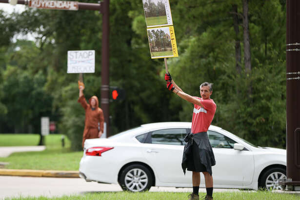Residents of the Village of Alden Bridge greeted parishioners at St. Anthony of Padua Catholic Church with a protest on Sunday.
