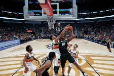 San Antonio Spurs forward LaMarcus Aldridge (12) works against New Orleans Pelicans forward Anthony Davis (23) in the first half of an NBA basketball game in New Orleans, Wednesday, Nov. 22, 2017. (AP Photo/Scott Threlkeld)