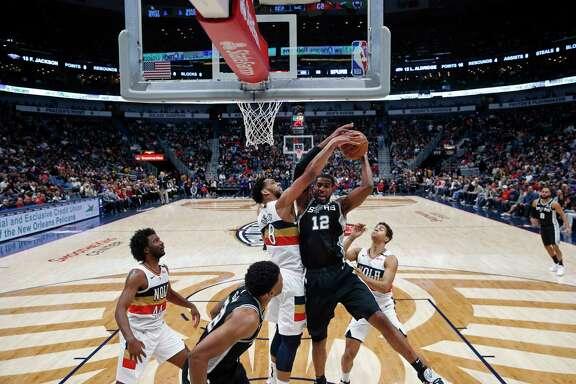 San Antonio Spurs forward LaMarcus Aldridge (12) works against New Orleans Pelicans forward Anthony Davis (23) in the first half of an NBA basketball game in New Orleans, Wednesday, Nov. 22, 2017. (AP Photo/Scott Threlkeld)