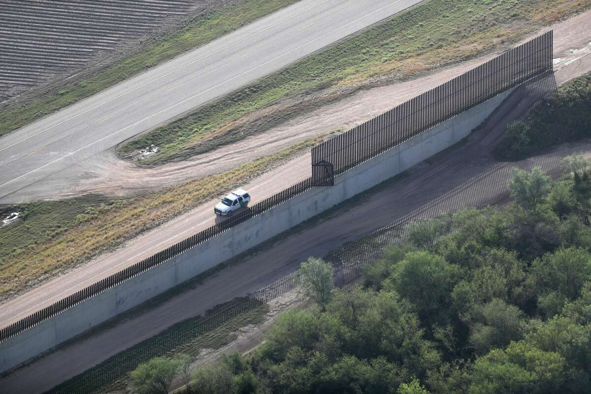 MCALLEN, TX - AUGUST 18: A U.S. Border Patrol vehicles sits near a U.S.-Mexico border fence on August 18, 2016 near McAllen, Texas. Border security has become a major issue in the U.S. presidential campaign. (Photo by John Moore/Getty Images)