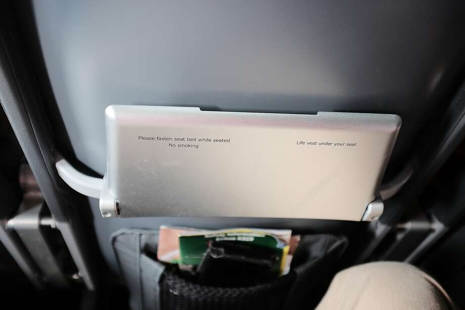 The seats on this Frontier Airlines Airbus are basically shells covered with thin padding. The tray tables could possibly support an iPad, but  not a laptop. Photo: Mike Moffitt/SFGate