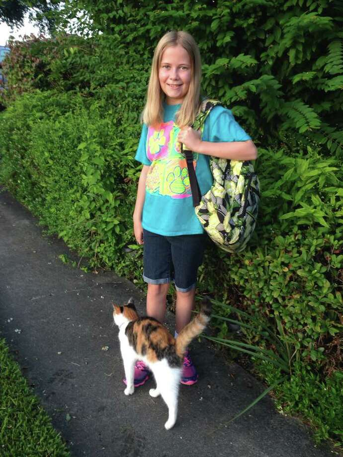 Grace Barger, Nederland Central Middle School, 5th grade, with her cat KittyBuu. Photo: Provided By Gail Pickens-Barger