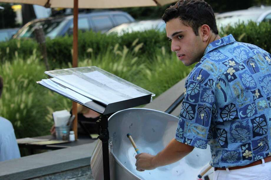 Stephen Blinder, 16, playing the steel drums at the Wilton Steel Community Band's performance on Tuesday, Aug. 16, at Wilton Pizza, 202 Town Green. Photo: Stephanie Kim / Hearst Connecticut Media