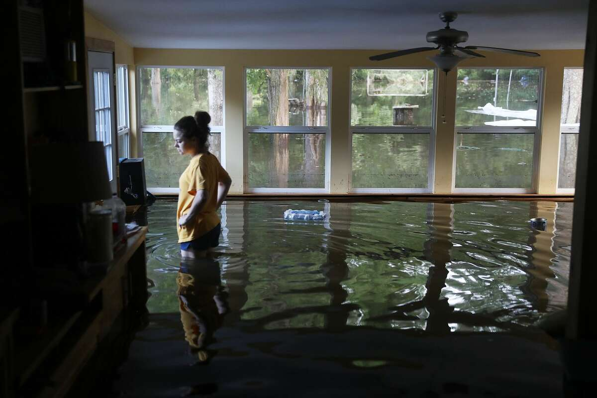 Leslie Andermann Gallagher surveys the flood damage to her home on Aug. 17, 2016, in Sorrento, La. The Baton Rouge area was overwhelmed with floodwater, leaving at least 12 people dead and thousands of homes damaged. (Photo by Joe Raedle/Getty Images)