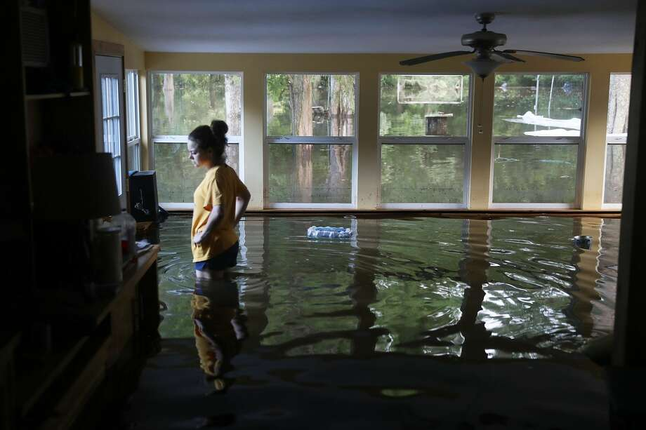Leslie Andermann Gallagher surveys the flood damage to her home on Aug. 17, 2016, in Sorrento, La. The Baton Rouge area was overwhelmed with floodwater, leaving at least 12 people dead and thousands of homes damaged. (Photo by Joe Raedle/Getty Images) Photo: Joe Raedle/Getty Images