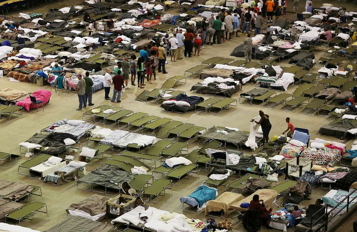 BATON ROUGE, LA - AUGUST 19: Evacuees take advantage of the shelter setup in the The Baton Rouge River Center arena as the area deals with the record flooding that took place causing thousands of people to seek temporary shelters on August 19, 2016 in Baton Rouge, Louisiana. Last week Louisiana was overwhelmed with flood water causing at least thirteen deaths and thousands of damaged homes. (Photo by Joe Raedle/Getty Images)