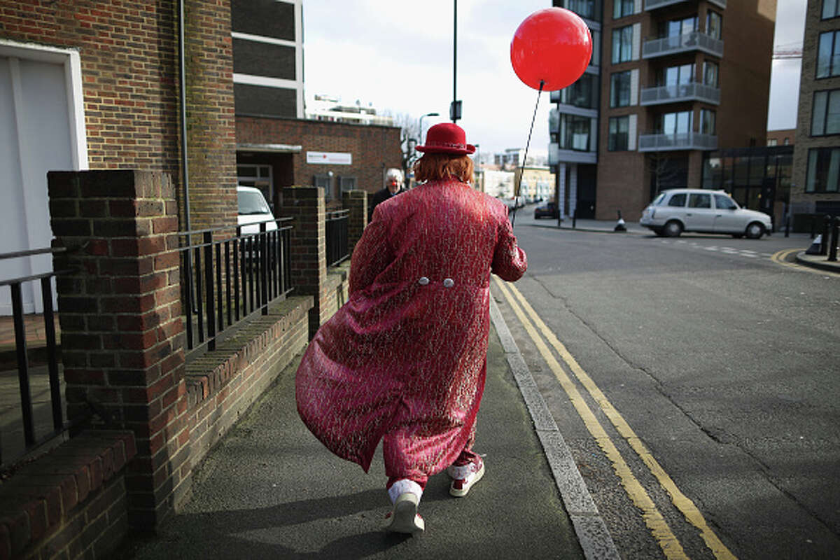 LONDON, ENGLAND - FEBRUARY 07: Clowns arrive ahead of the 70th anniversary Clown Church Service at All Saints Church in Haggerston on February 7, 2016 in London, England. Clowns attended the service in memory of Joseph Grimaldi (1778-1837), the most celebrated English clown who was born in London. The service has been an annual tradition since 1946.