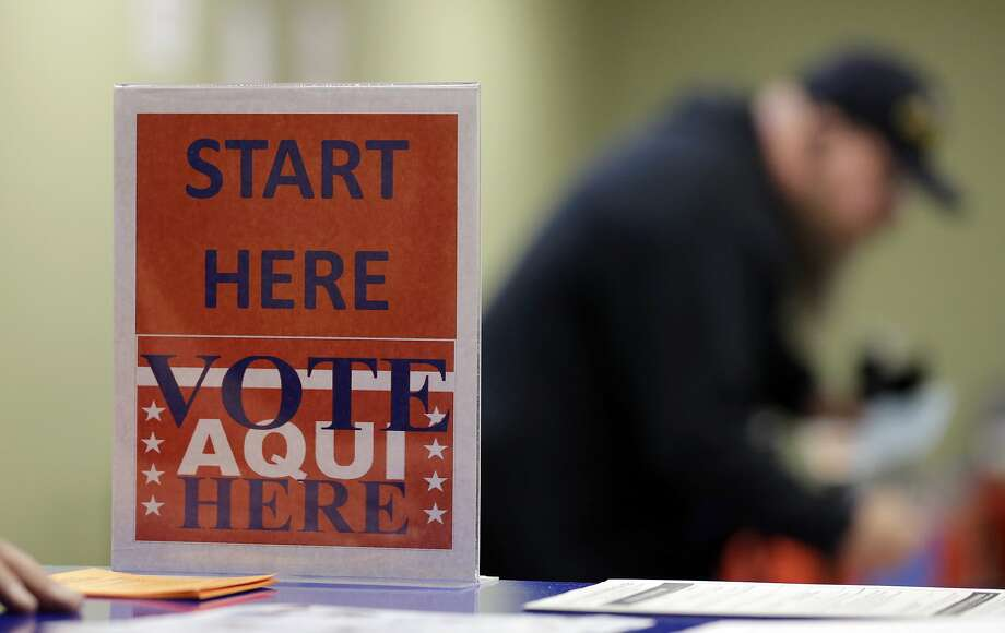 In this Feb. 26, 2014 photo, a voter prepares to cast his ballot at an early voting polling site, in Austin, Texas. (AP Photo/Eric Gay) Photo: Eric Gay, Associated Press
