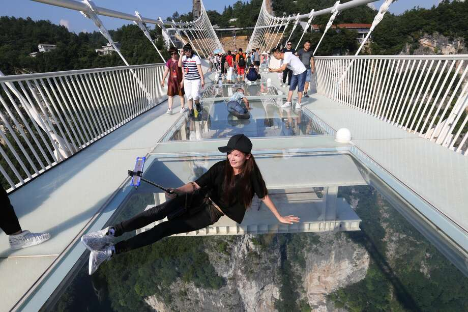 file a tourist takes a selfie on the glass bottom bridge at zhangjiajie - Zhangjiajie Glass Bridge