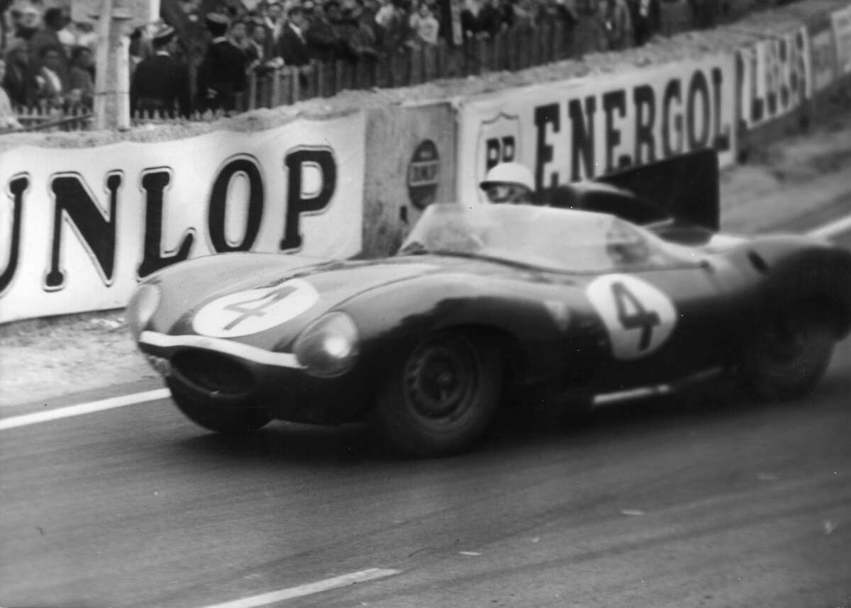 Ninian Sanderson and Ron Flockhart drive a Jaguar D-type to victory in the 1956 Le Mans 24 hour classic.