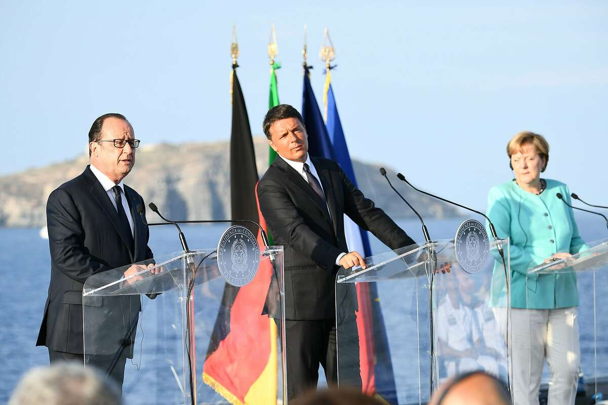 French President Francois Hollande (L), flanked by Italian Prime Minister Matteo Renzi (C) and German Chancellor Angela Merkel (R), delivers a speech during a joint press conference held aboard of the Garibaldi navy on the harbour of Italian island of Ventotene, ahead of a meeting on the island, where the leaders of Italy, France and Germany meet to discuss the post-Brexit EU. Europe's economic outlook, jihadist attacks, the refugee and migrant drama, the Syrian conflict, and relations with Russia and Turkey were all on the agenda for the talks later Monday on the island of Ventotene, one of the cradles of the European dream. / AFP PHOTO / VINCENZO PINTOVINCENZO PINTO/AFP/Getty Images