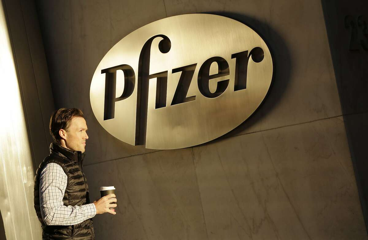 FILE - In this Monday, Nov. 23, 2015, file photo, a man enters Pfizer's world headquarters, in New York. Pfizer is buying biopharmaceutical company Medivation in a deal valued at about $14 billion. Medivation Inc.�s stock soared more than 19 percent in Monday, Aug. 22, 2016 premarket trading. (AP Photo/Mark Lennihan, File)