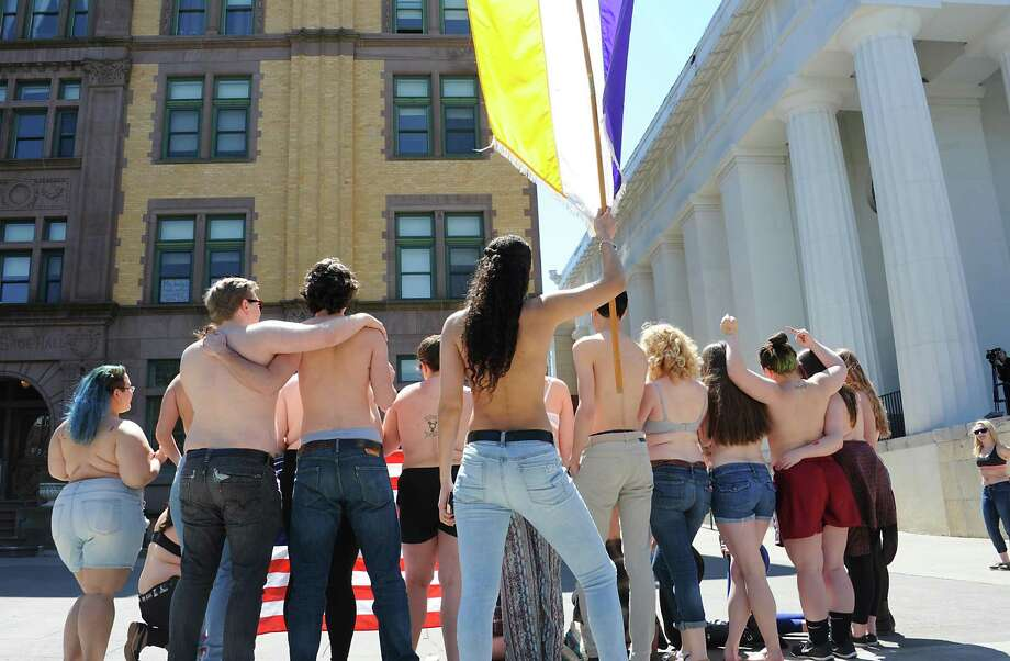 Sage students, upset by police treatment of Cedar Brock, who identifies as androgynous, hold a topless protest in Sage Park on the Russell Sage College campus Wednesday, April 120, 2016 in Troy, N.Y. A school security officer approached Cedar, who was sunbathing topless in a public park that fronts the campus. (Lori Van Buren / Times Union) Photo: Lori Van Buren / 10036264A