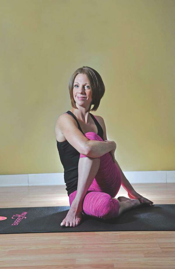 Karli Taylor, owner of Poise and creator of BarreFlow, poses for a photo at her studio on Tuesday, May 10, 2016, in Slingerlands, N.Y.  (Paul Buckowski / Times Union) Photo: PAUL BUCKOWSKI / 20036506A