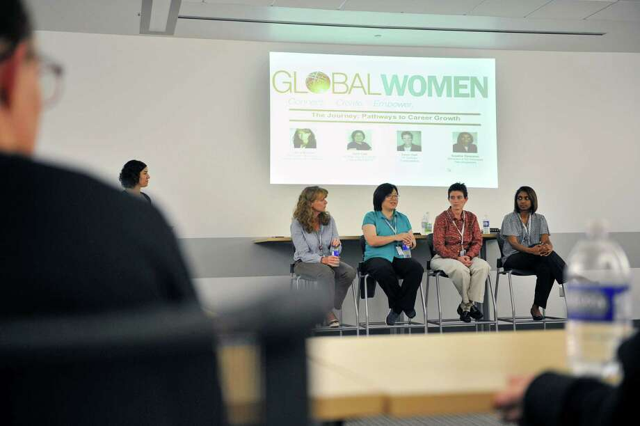 Seated background from left to right, GlobalFoundries employees, Laura Brown, director strategic agreements and initiatives, Julie Lee, senior manager/deputy director CFM characterization, Dawn Hall, vice president design enablement for GlobalFoundries and Sujatha Sankaran, director ATD process development for GlobalFoundries, take part in a GlobalWomen panel discussion entitled, The Journey: Pathways to Career Growth on Tuesday, May 24, 2016, in Malta, N.Y.  The panel discussion was moderated by Iris Galvez, background standing, principal engineer, process engineering ATD infrastructure for GlobalFoundries.  The GlobalWomen networking group is held for employees of GlobalFoundries.  (Paul Buckowski / Times Union) Photo: PAUL BUCKOWSKI / 40036623A