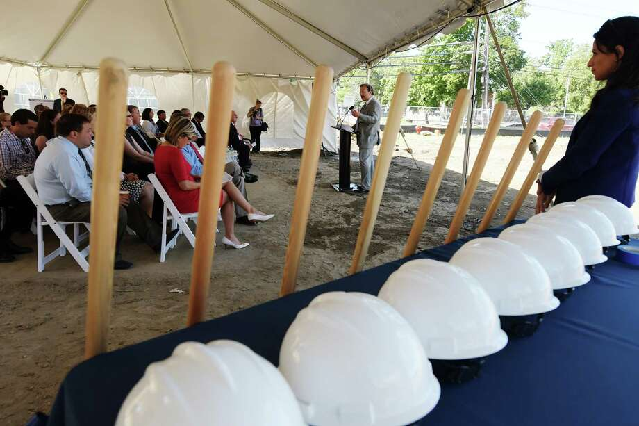 Dr. Ferdinand Venditti, background right, Albany Medical Center executive vice president for system care delivery and hospital general director, addresses those gathered for  a ground-breaking  for the new medical office building at 1769 Union St. on Monday, August 22, 2016, in Niskayuna, N.Y.   (Paul Buckowski / Times Union) Photo: PAUL BUCKOWSKI / 20037724A