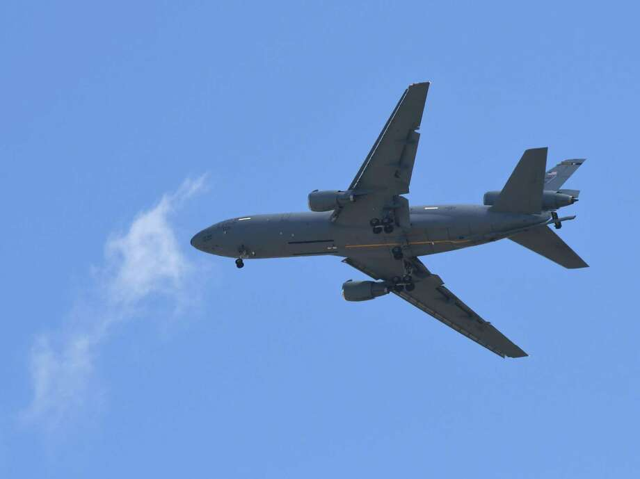 A KC-10 Extender refueling plane from McGuire Air Force base in N.J., flies  low over downtown Albany on Monday midday, Aug. 22, 2016, in Albany, N.Y. Albany International Airport is often used by federal aircraft to conduct touch-and-go landings during training exercises. (Will Waldron/Times Union) Photo: Will Waldron