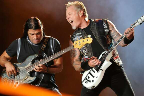 (FILES) This file photo taken on September 19, 2015 shows Robert Trujillo (L) and James Hetfield of Metallica performing on the second day of the Rock in Rio music festival in Rio de Janeiro. Heavy metal band Metallica is coming out with its first album in eight years, the group announced Thursday. / AFP PHOTO / TASSO MARCELOTASSO MARCELO/AFP/Getty Images