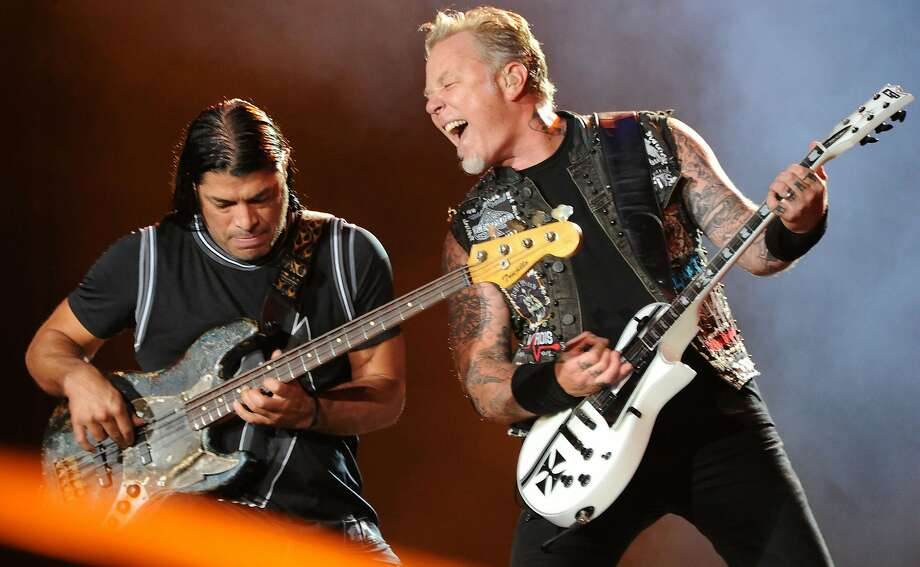(FILES) This file photo taken on September 19, 2015 shows Robert Trujillo (L) and James Hetfield of Metallica performing on the second day of the Rock in Rio music festival in Rio de Janeiro. Heavy metal band Metallica is coming out with its first album in eight years, the group announced Thursday. / AFP PHOTO / TASSO MARCELOTASSO MARCELO/AFP/Getty Images Photo: TASSO MARCELO, AFP/Getty Images