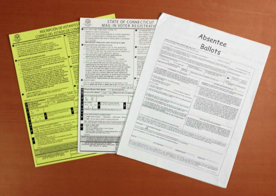 Paperwork needed to register for an absentee ballot. Photo: Thane Grauel / Hearst Connecticut Media / Connecticut Post