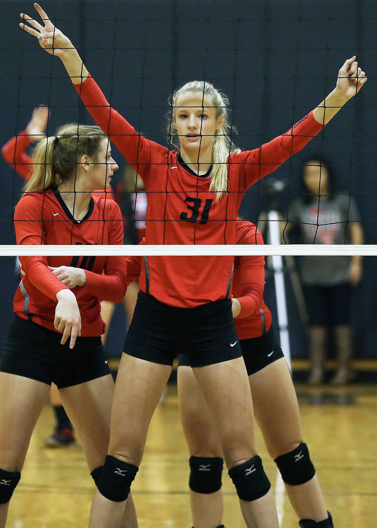 Brooke Kanas imposes on the middle as New Braunfels Canyon beats Johnson 3-1 to advance to the 6A regional tournament on Nov. 10, 2015.