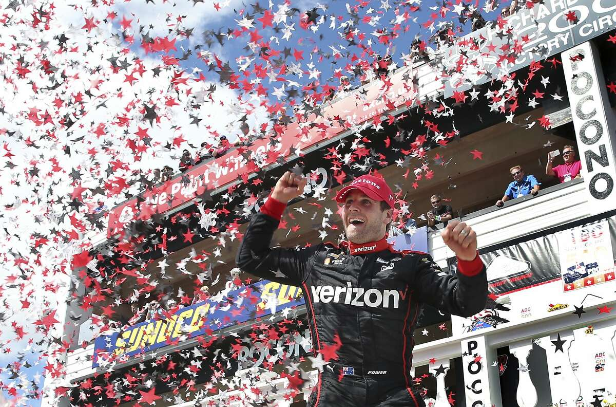Will Power, of Australia, celebrates in Victory Lane after winning the Pocono IndyCar 500 auto race Monday, Aug. 22, 2016, in Long Pond, Pa. (AP Photo/Mel Evans)