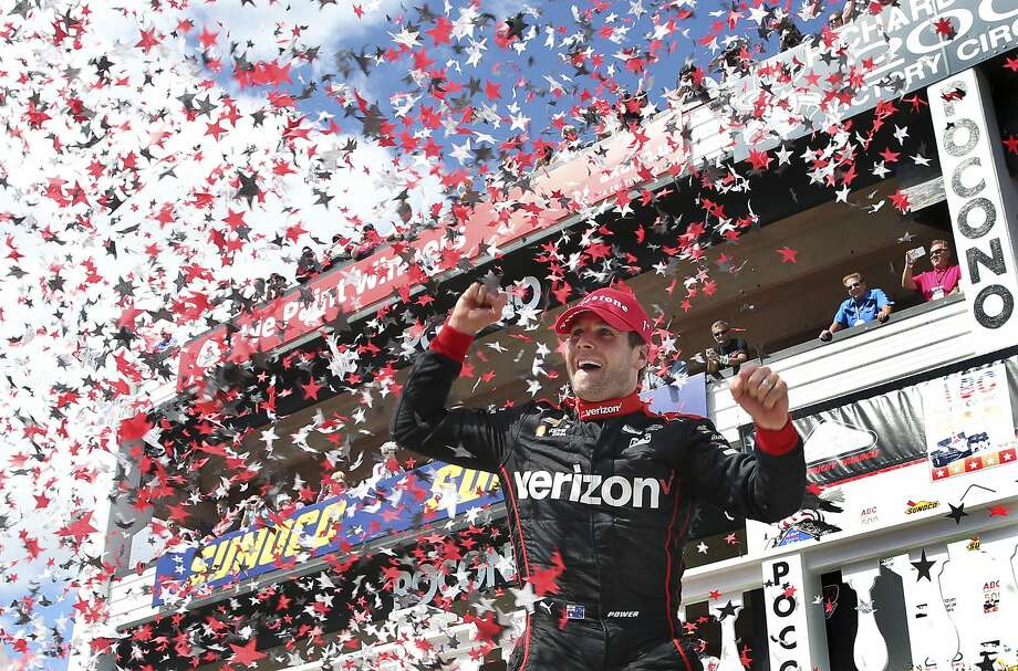Will Power celebrates at Pocono Raceway, where he produced his fourth victory in his past six IndyCar races. Photo: Mel Evans, Associated Press