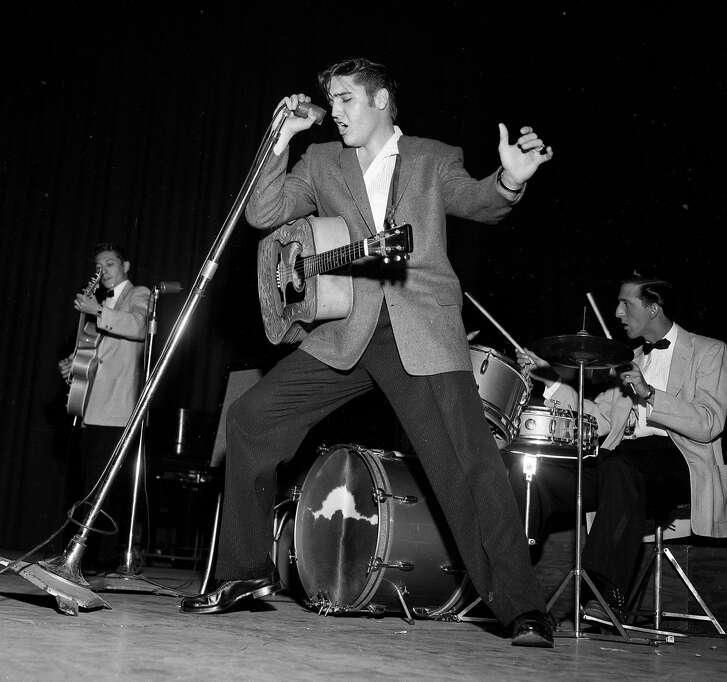 Elvis Presley performs at the Oakland Auditorium June 3, 1956