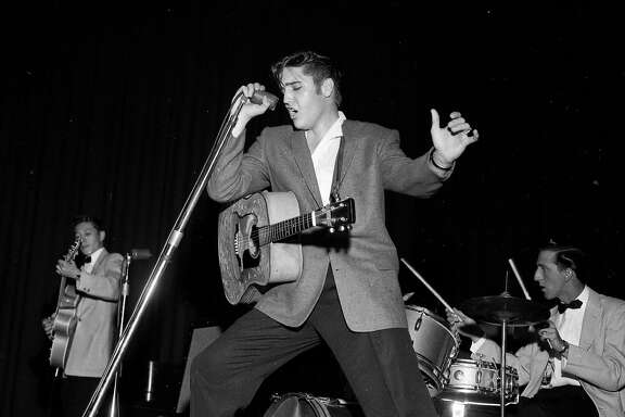 Elvis Presley performs at the Oakland Auditorium June 3, 1956
