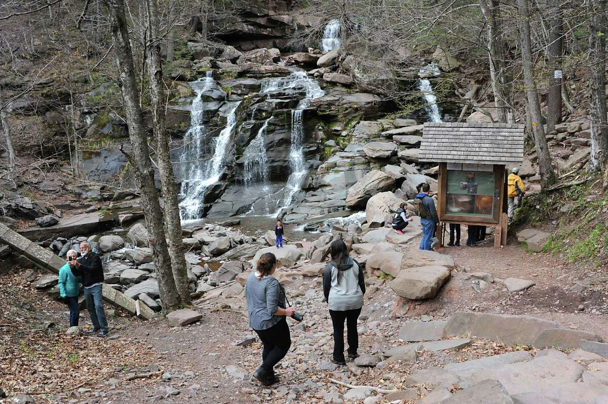 People visit and hike the Kaaterskill Falls on Thursday, April 28, 2016 in Haines Falls, N.Y. (Lori Van Buren / Times Union)