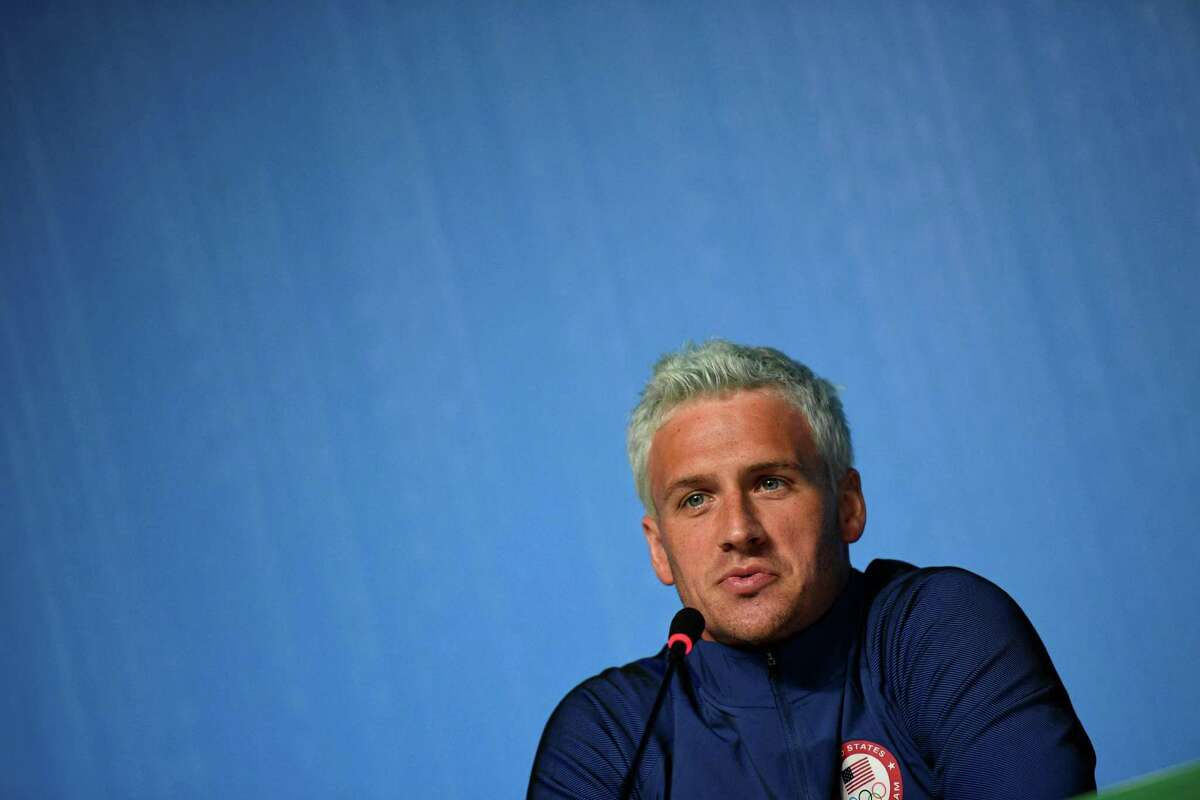 """(FILES) This file photo taken on August 03, 2016 shows US swimmer Ryan Lochte holding a press conference in Rio de Janeiro, two days ahead of the opening ceremony of the Rio 2016 Olympic Games. Star American swimmer Ryan Lochte said August 20, 2016 he took """"full responsibility"""" for vandalizing a gas station bathroom and then telling police an """"overexaggerated"""" story about it during the Rio Olympics. The episode, which has embarrassed the US sporting superpower, saw Lochte and three other gold-winning US swimmers embroiled in a controversy after he gave a shocking -- and false -- account of how they had been robbed at gunpoint. / AFP PHOTO / MARTIN BUREAUMARTIN BUREAU/AFP/Getty Images"""