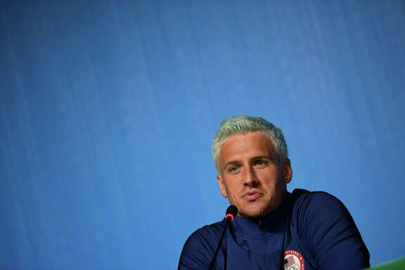 "(FILES) This file photo taken on August 03, 2016 shows US swimmer Ryan Lochte holding a press conference in Rio de Janeiro, two days ahead of the opening ceremony of the Rio 2016 Olympic Games. Star American swimmer Ryan Lochte said August 20, 2016 he took ""full responsibility"" for vandalizing a gas station bathroom and then telling police an ""overexaggerated"" story about it during the Rio Olympics. The episode, which has embarrassed the US sporting superpower, saw Lochte and three other gold-winning US swimmers embroiled in a controversy after he gave a shocking -- and false -- account of how they had been robbed at gunpoint.  / AFP PHOTO / MARTIN BUREAUMARTIN BUREAU/AFP/Getty Images"