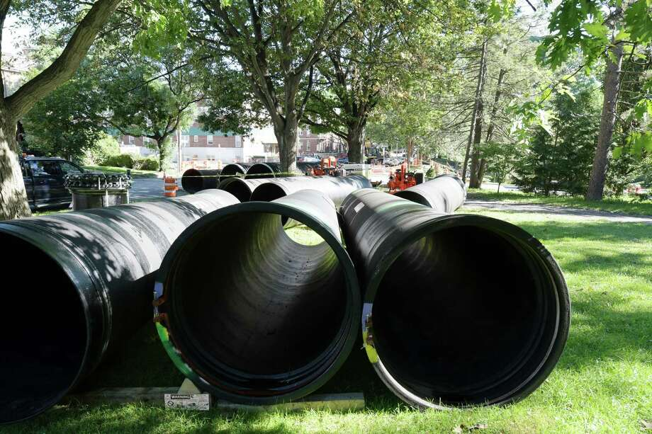 Large pipes are seen in a staging area for supplies as work to repair a sinkhole continues on South Lake Ave. on Monday, Aug. 22, 2016, in Albany, N.Y.  (Paul Buckowski / Times Union)