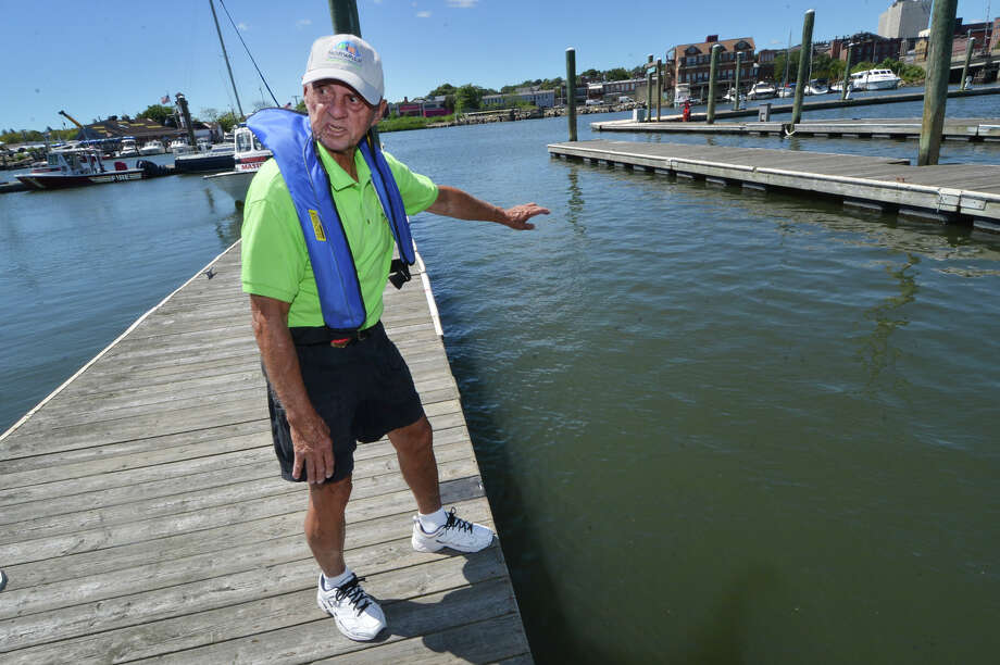 Dockmaster Joe Rotondo stands at the spot painted on the dock while people launch boats at the public boat launch ramps at Veterans Memorial Park in Norwalk on Monday, Aug. 22. Past that spot the boat trailer gets stuck in the mud and would require a tow truck to get it out. The Common Council will vote on Tuesday for funds to repair and upgrade the area at the park. Photo: Alex Von Kleydorff / Hearst Connecticut Media / Connecticut Post