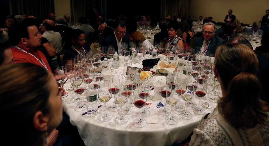 "A table in the Grand Tasting room during the Periwinkle Foundation's ""Iron Sommelier"" annual wine tasting and sommelier competition at the Houstonian Hotel Thursday, Oct. 2, 2014, in Houston. ( James Nielsen / Houston Chronicle ) Photo: James Nielsen, Staff / © 2014  Houston Chronicle"