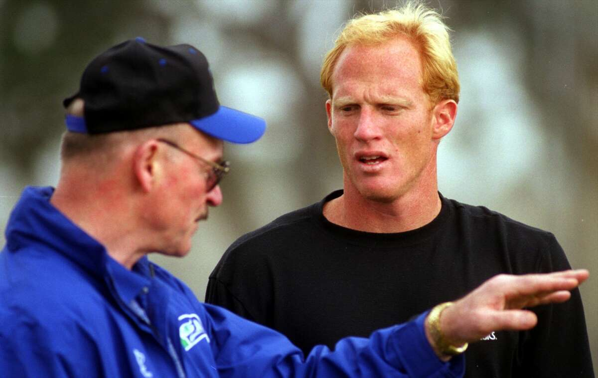 Former Oakland Raiders QB Todd Marinovich (R) listens as Seattle Seahawks scouting director Bill Quinter describes a pass play. Marinovich, who is attempting an NFL comeback, tossed passes for about an hour at Orange Coast College on Friday morning. (Photo by Don Bartletti/Los Angeles Times via Getty Images)