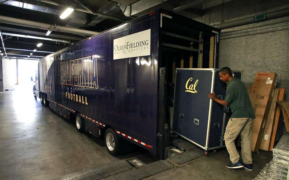 Mover LaVaughn Ellis loads trunks full of equipment into a semi trailer at Memorial Stadium in Berkeley on Friday, the day before the Cal football team, and all of its gear, took off on a charter jet to Sydney for a game against Hawaii. Photo: Michael Macor, The Chronicle